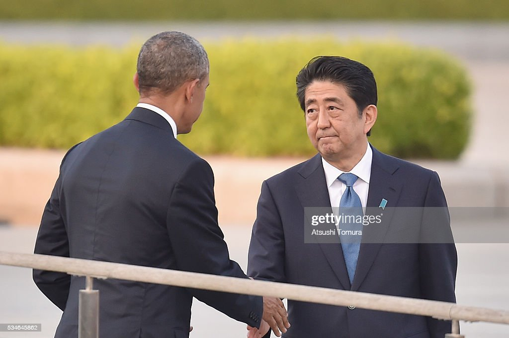 U.S. President <a gi-track='captionPersonalityLinkClicked' href=/galleries/search?phrase=Barack+Obama&family=editorial&specificpeople=203260 ng-click='$event.stopPropagation()'>Barack Obama</a> (L) shakes hands with Japanese Prime Minister <a gi-track='captionPersonalityLinkClicked' href=/galleries/search?phrase=Shinzo+Abe&family=editorial&specificpeople=559017 ng-click='$event.stopPropagation()'>Shinzo Abe</a> during his visit to the Hiroshima Peace Memorial Park on May 27, 2016 in Hiroshima, Japan. It is the first time U.S. President makes an official visit to Hiroshima, the site where the atomic bomb was dropped in the end of World War II on August 6, 1945.