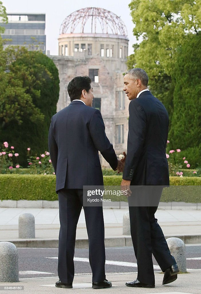 U.S. President <a gi-track='captionPersonalityLinkClicked' href=/galleries/search?phrase=Barack+Obama&family=editorial&specificpeople=203260 ng-click='$event.stopPropagation()'>Barack Obama</a> (R) shakes hands with Japanese Prime Minister <a gi-track='captionPersonalityLinkClicked' href=/galleries/search?phrase=Shinzo+Abe&family=editorial&specificpeople=559017 ng-click='$event.stopPropagation()'>Shinzo Abe</a> at the Peace Memorial Park in Hiroshima on May 27, 2016. Obama became the first sitting U.S. president to visit the atomic-bombed city.