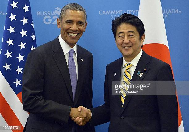 US President Barack Obama shakes hands with Japans Prime Minister Shinzo Abe before a bilateral meeting on the sideline of the G20 summit in Saint...