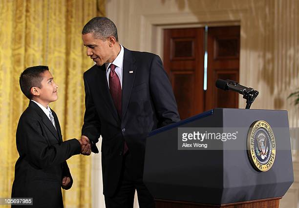 S President Barack Obama shakes hands with Javier Garcia prior to signing the Executive Order on the White House Initiative on Educational Excellence...
