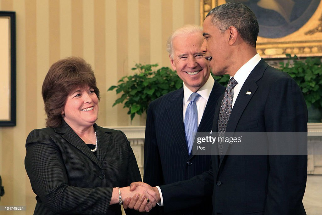 President <a gi-track='captionPersonalityLinkClicked' href=/galleries/search?phrase=Barack+Obama&family=editorial&specificpeople=203260 ng-click='$event.stopPropagation()'>Barack Obama</a> (R) shakes hands with <a gi-track='captionPersonalityLinkClicked' href=/galleries/search?phrase=Julia+Pierson&family=editorial&specificpeople=10620908 ng-click='$event.stopPropagation()'>Julia Pierson</a> (L) after Vice President <a gi-track='captionPersonalityLinkClicked' href=/galleries/search?phrase=Joseph+Biden&family=editorial&specificpeople=206897 ng-click='$event.stopPropagation()'>Joseph Biden</a> administered the oath of office to her to become the Director of the United States Secret Service in the Oval Office of the White House March 27, 2013 in Washington, DC. Pierson is the first woman to head the agency.