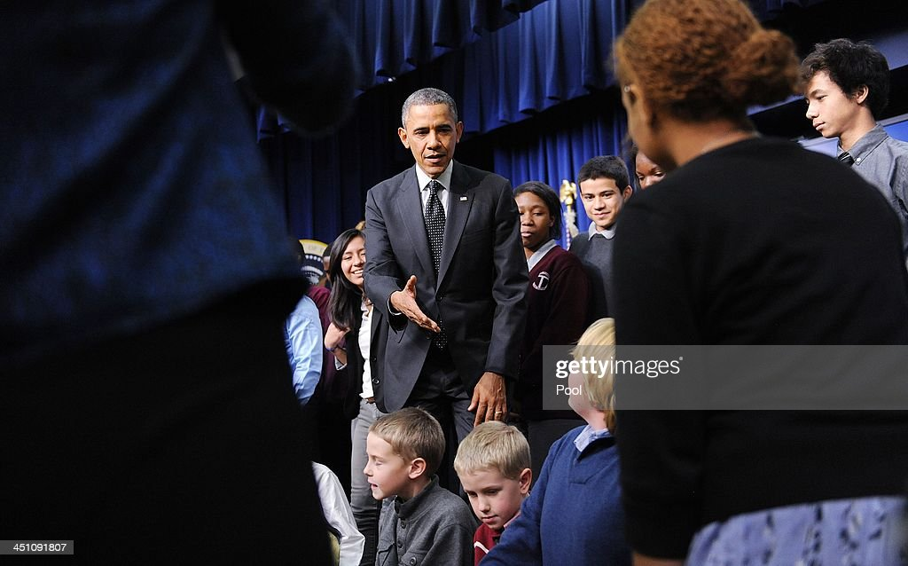 President <a gi-track='captionPersonalityLinkClicked' href=/galleries/search?phrase=Barack+Obama&family=editorial&specificpeople=203260 ng-click='$event.stopPropagation()'>Barack Obama</a> shakes hands with kids after speaking to a group of educators in the South Court Auditorium of the White House November 21, 2013 in Washington, DC. They were being honored as ConnectED Champions of Change for taking creative approaches in using technology to enhance learning for students in communities across the country.