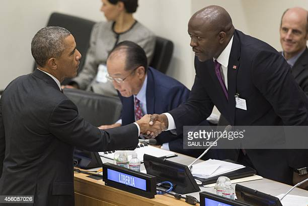 US President Barack Obama shakes hands with Liberia's Foreign Minister Augustine Kpehe Ngafuan after speaking about the Ebola epidemic during the UN...