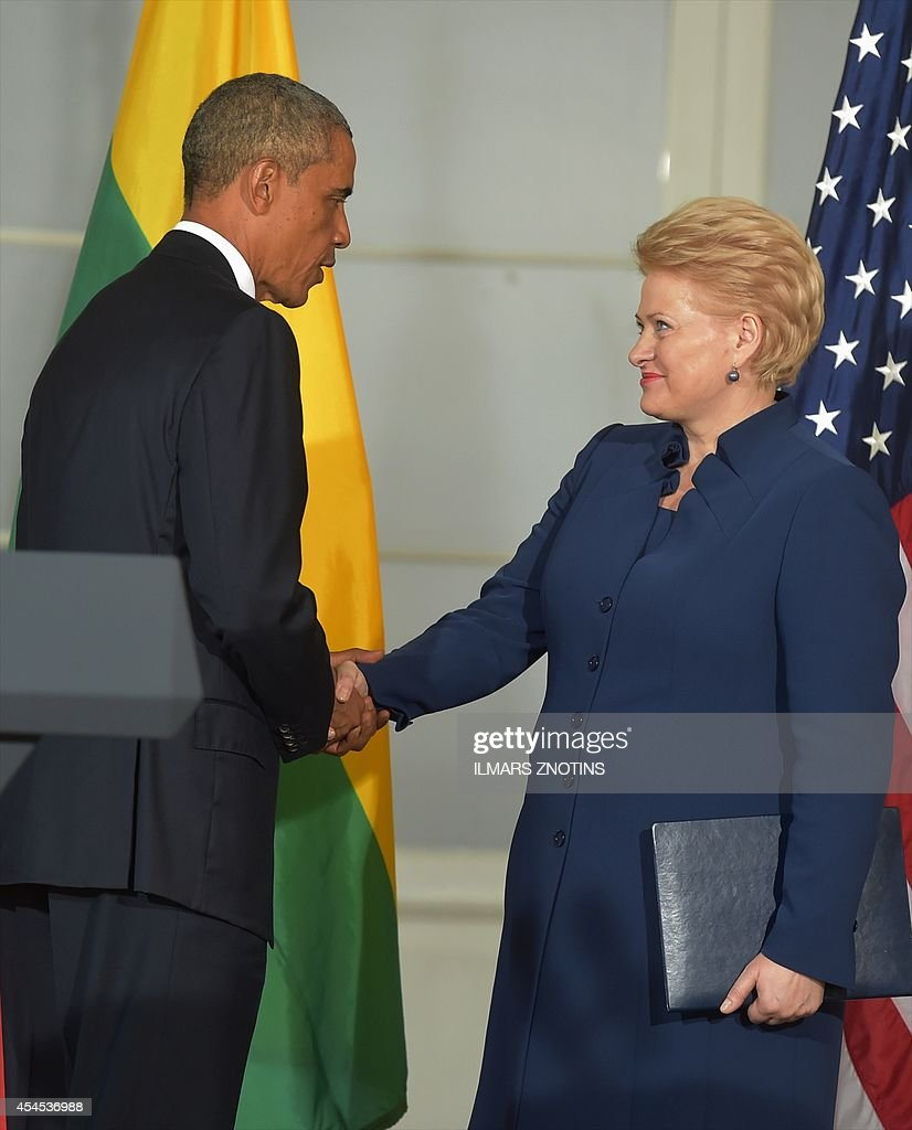 US President <a gi-track='captionPersonalityLinkClicked' href=/galleries/search?phrase=Barack+Obama&family=editorial&specificpeople=203260 ng-click='$event.stopPropagation()'>Barack Obama</a> (L) shakes hands with Lithuania's President Dalia Grybauskaite following meetings at the Kadriorg Art Museum in Tallinn, Estonia, September 3, 2014. US President <a gi-track='captionPersonalityLinkClicked' href=/galleries/search?phrase=Barack+Obama&family=editorial&specificpeople=203260 ng-click='$event.stopPropagation()'>Barack Obama</a> underscored Washington's commitment to the security of NATO allies, announcing additional US planes to police the skies over Europe's eastern flank bordering Russia.