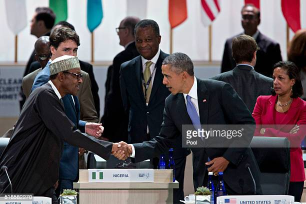 US President Barack Obama shakes hands with Muhammadu Buhari Nigeria's president during a closing session at the Nuclear Security Summit April 1 2016...