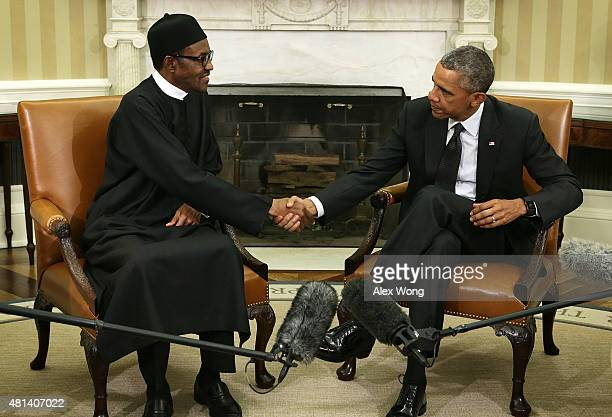 US President Barack Obama shakes hands with Nigerian President Muhammadu Buhari during a meeting in the Oval Office of the White House July 20 2015...