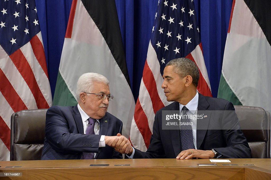 US President Barack Obama shakes hands with Palestinian Authority President Mahmoud Abbas after making a statement to the media before their bilateral meeting on the sideline of the 68th United Nations General Assembly at the UN in New York on September 24, 2013. Obama demanded that the world take action on Syria, saying that the regime must face consequences after the use of chemical weapons. Speaking before the UN General Assembly, Obama defended his threat of force against Syrian President Bashar al-Assad's regime and denounced critics who accuse the United States of inconsistency. AFP Photo/Jewel Samad