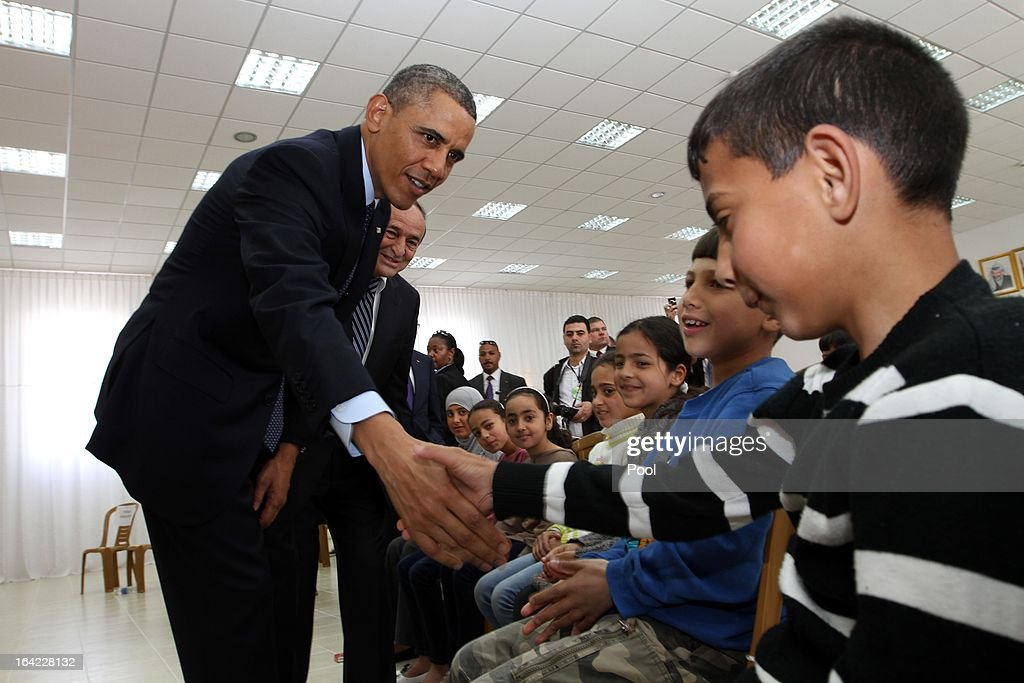 U.S. President <a gi-track='captionPersonalityLinkClicked' href=/galleries/search?phrase=Barack+Obama&family=editorial&specificpeople=203260 ng-click='$event.stopPropagation()'>Barack Obama</a> shakes hands with Palestinian children during his visit to Al Bera Youth Center March 21, 2013 in Ramallah, the West Bank. This is Obama's first visit as president to the region and his itinerary includes meetings with the Palestinian and Israeli leaders as well as a visit to the Church of the Nativity in Bethlehem.