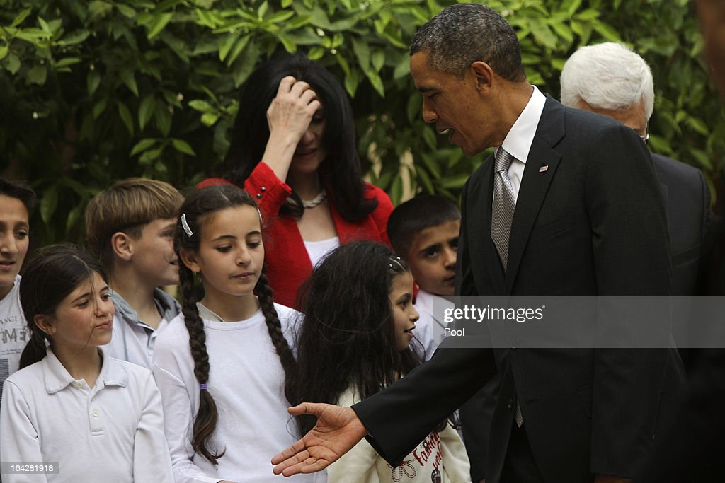 U.S. President Barack Obama shakes hands with Palestinian kids during a visit to the Church of the Nativity on March 22, 2013 in Bethlehem, West Bank. This is Obama's first visit as president to the region and his itinerary includes meetings with the Palestinian and Israeli leaders as well as a visit to the Church of the Nativity in Bethlehem.