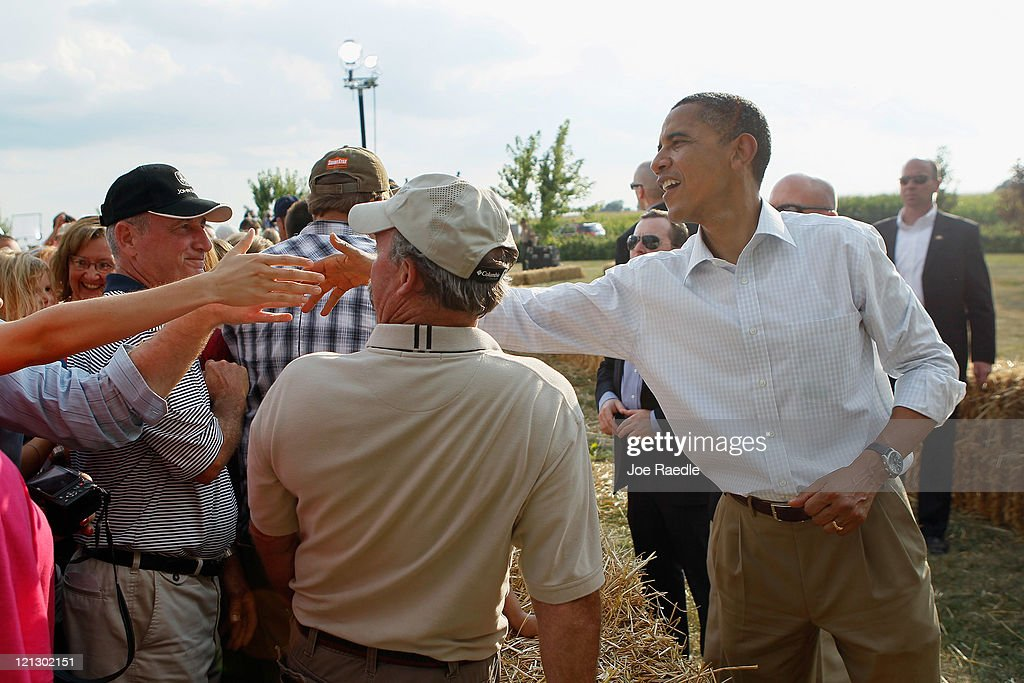 U.S. President <a gi-track='captionPersonalityLinkClicked' href=/galleries/search?phrase=Barack+Obama&family=editorial&specificpeople=203260 ng-click='$event.stopPropagation()'>Barack Obama</a> shakes hands with people after speaking at a town hall style meeting at Country Corner Farm Market on August 17, 2011 in Alpha, Illinois. President Obama is on the last day of a three-day bus tour of Minnesota, Iowa and Illinois during which he will discuss ways to improve the economy and create jobs, and hear directly from Americans.