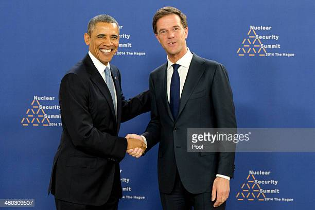 President Barack Obama shakes hands with Prime Minister of the Netherlands Mark Rutte at the World Forum Convention Center ahead of the 2014 Nuclear...