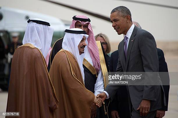 US President Barack Obama shakes hands with Prince Faisal bin Bandar bin Abdelaziz alSaud Governor of Riyadh as he arrives at King Khalid...