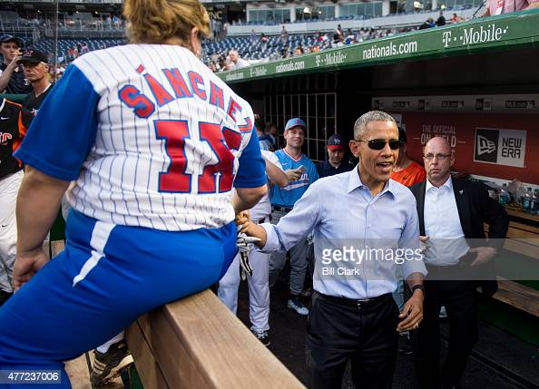 President Barack Obama shakes hands with Rep Linda Sanchez DCalif as other players in the Democrats' dugout look on during the 54th Annual Roll Call...