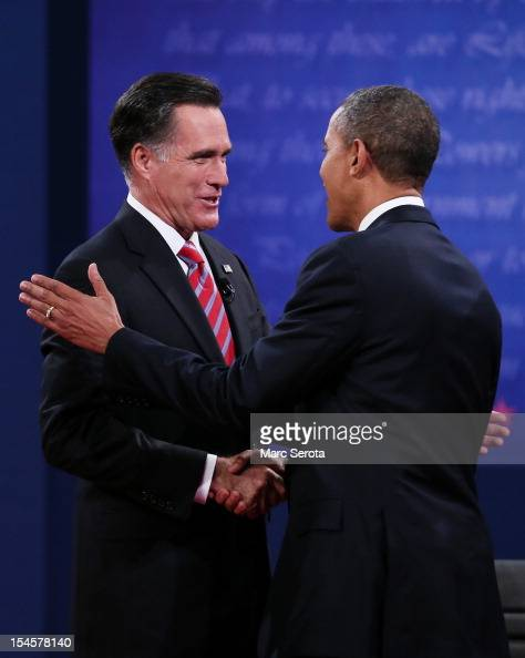 S President Barack Obama shakes hands with Republican presidential candidate Mitt Romney at the Keith C and Elaine Johnson Wold Performing Arts...