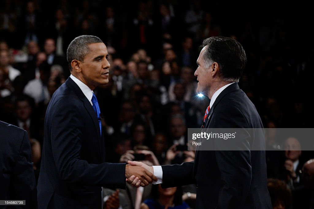 U.S. President Barack Obama (L) shakes hands with Republican presidential candidate Mitt Romney after the debate at the Keith C. and Elaine Johnson Wold Performing Arts Center at Lynn University on October 22, 2012 in Boca Raton, Florida. The focus for the final presidential debate before Election Day on November 6 is foreign policy.