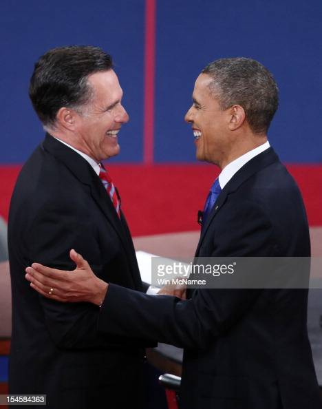 S President Barack Obama shakes hands with Republican presidential candidate Mitt Romney after the debate at the Keith C and Elaine Johnson Wold...