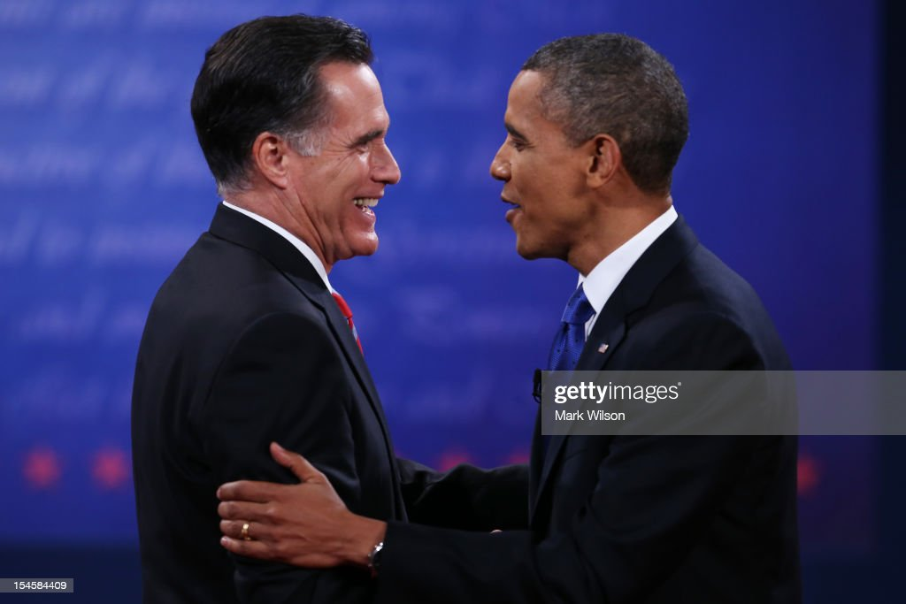U.S. President Barack Obama (R) shakes hands with Republican presidential candidate Mitt Romney after the debate at the Keith C. and Elaine Johnson Wold Performing Arts Center at Lynn University on October 22, 2012 in Boca Raton, Florida. The focus for the final presidential debate before Election Day on November 6 is foreign policy.