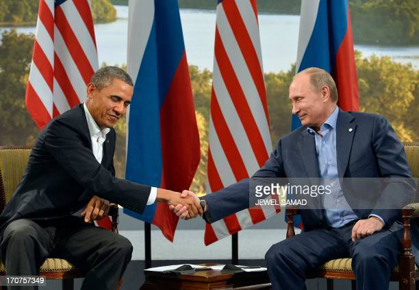 US President Barack Obama shakes hands with Russian President Vladimir Putin during a bilateral meeting on the sidelines of the G8 summit at the...