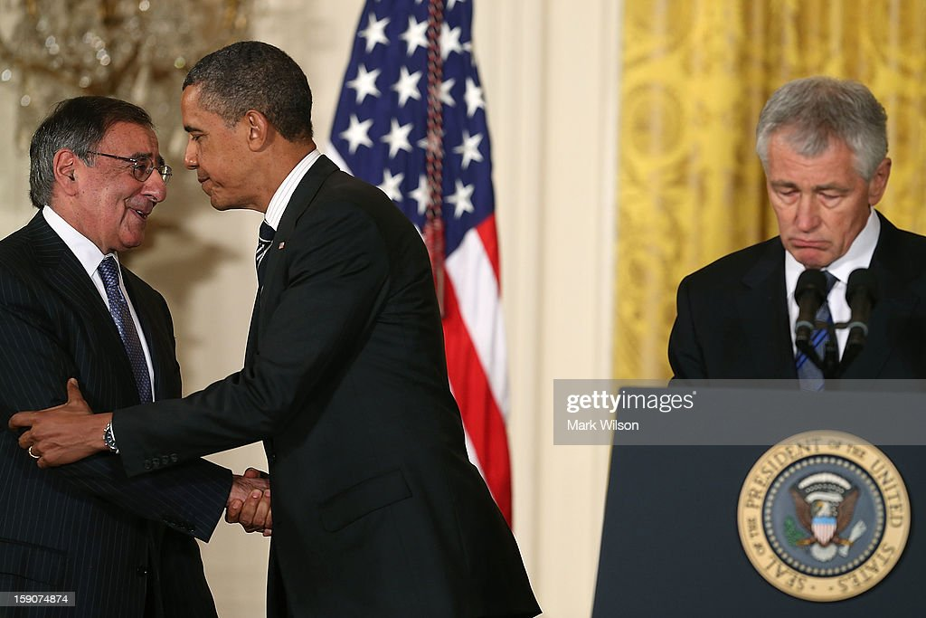 U.S. President <a gi-track='captionPersonalityLinkClicked' href=/galleries/search?phrase=Barack+Obama&family=editorial&specificpeople=203260 ng-click='$event.stopPropagation()'>Barack Obama</a> (C) shakes hands with Secretary of Defense Leon Panetta (L), after nominating former U.S. Sen. <a gi-track='captionPersonalityLinkClicked' href=/galleries/search?phrase=Chuck+Hagel&family=editorial&specificpeople=504963 ng-click='$event.stopPropagation()'>Chuck Hagel</a> (R-NE) (R) to be Defense Secretary during an event in the East Room at the White House on January 7, 2013 in Washington, DC. Pending approval by the Senate, the nomination of former U.S. Sen. <a gi-track='captionPersonalityLinkClicked' href=/galleries/search?phrase=Chuck+Hagel&family=editorial&specificpeople=504963 ng-click='$event.stopPropagation()'>Chuck Hagel</a> (R-NE) as Secretary of Defense will replace Leon Panetta.