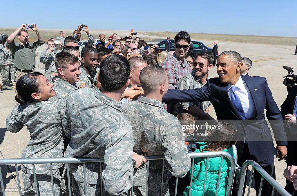 US President Barack Obama (R) shakes hands with soldiers upon arriving at the Buckley Air Force Base in Denver, Colorado, on April 3, 2013. Obama has demanded votes on measures including a requirement for background checks on all gun purchases, limits on high capacity ammunition magazines, a reinstated assault weapons ban, new gun trafficking laws, and new school safety plans. But the assault weapons ban push appears certain to fail to get sufficient support in the Senate, following a huge campaign by the gun lobby and opposition from Republicans and Democrats from conservative and rural areas. AFP PHOTO/Jewel Samad