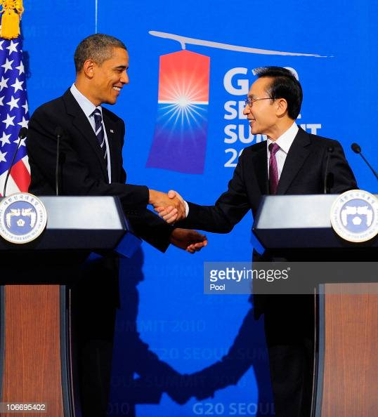 S President Barack Obama shakes hands with South Korean President Lee Myungbak during a joint press conference at the Presidential Blue House after...