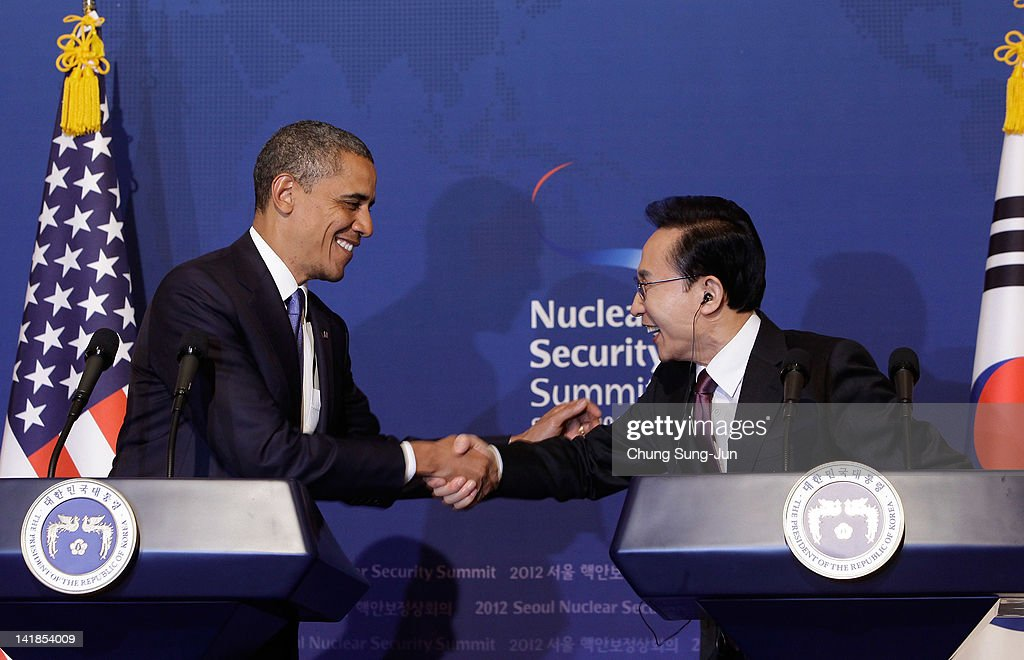 U.S. President Barack Obama (L) shakes hands with South Korean President Lee Myung-Bak during a joint press conference at the presidential house on March 25, 2012 in Seoul, South Korea. World leaders are gathering in Seoul to discuss the threat of nuclear terrorism, the recurrence nuclear power plant meltdown and to minimize nuclear material across the world.
