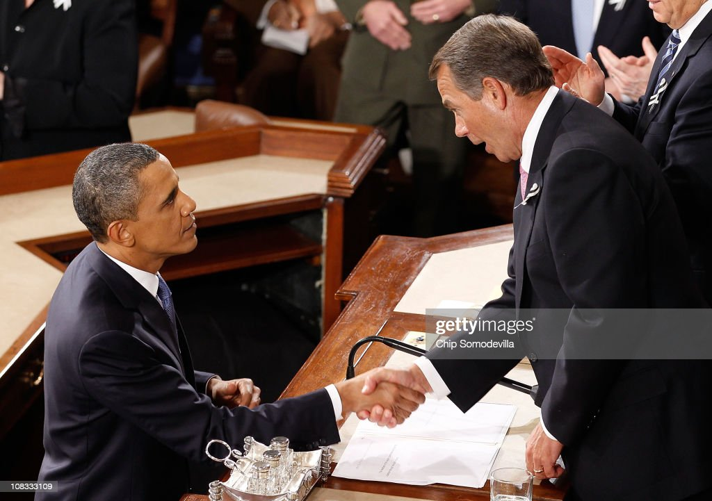 U.S. President <a gi-track='captionPersonalityLinkClicked' href=/galleries/search?phrase=Barack+Obama&family=editorial&specificpeople=203260 ng-click='$event.stopPropagation()'>Barack Obama</a> shakes hands with Speaker of the House John Boehner (R) after delivering his State of the Union speech January 25, 2011 in Washington, DC. During his speech Obama was expected to focus on the U.S. economy and increasing education and infrastructure funding while proposing a three-year partial freeze of domestic programs and $78 billion in military spending cuts.