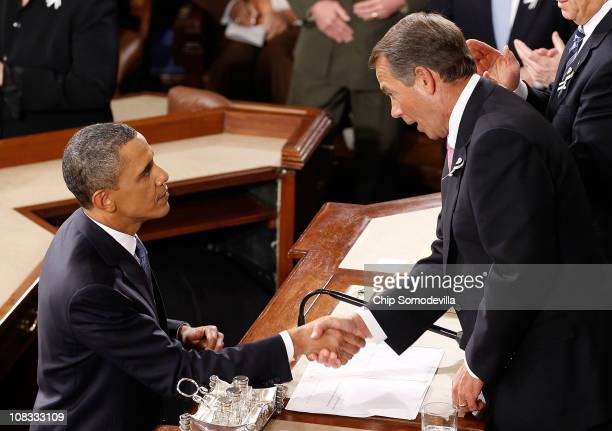S President Barack Obama shakes hands with Speaker of the House John Boehner after delivering his State of the Union speech January 25 2011 in...