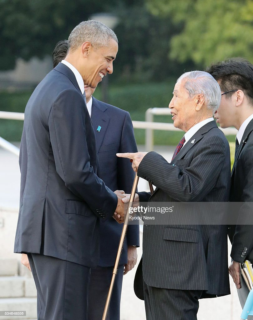 U.S. President Barack Obama (L) shakes hands with Sunao Tsuboi, a 91-year-old survivor of the U.S. atomic bombing, at the Peace Memorial Park in Hiroshima on May 27, 2016. In his speech, Obama, the first sitting U.S. president to visit the atomic-bombed city, talked of the need to pursue a world without nuclear weapons.