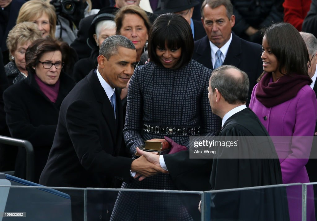 U.S. President Barack Obama (L) shakes hands with Supreme Court Chief Justice John Roberts after being sworn in during the presidential inauguration on the West Front of the U.S. Capitol January 21, 2013 in Washington, DC. Barack Obama was re-elected for a second term as President of the United States.