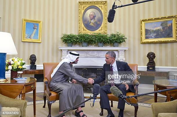 US President Barack Obama shakes hands with the Crown Prince of Abu Dhabi Sheikh Mohammed bin Zayed alNahyan during a greeting in the Oval Office of...