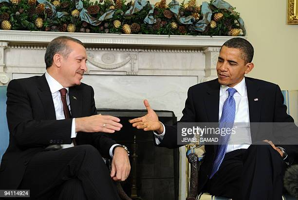 US President Barack Obama shakes hands with Turkish Prime Minister Recep Tayyip Erdogan during a meeting in the Oval Office at the White House in...