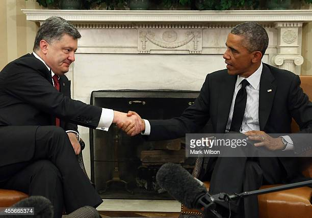S President Barack Obama shakes hands with Ukraine President Petro Poroshenko in the Oval Office at the White House September 18 2014 in Washington...
