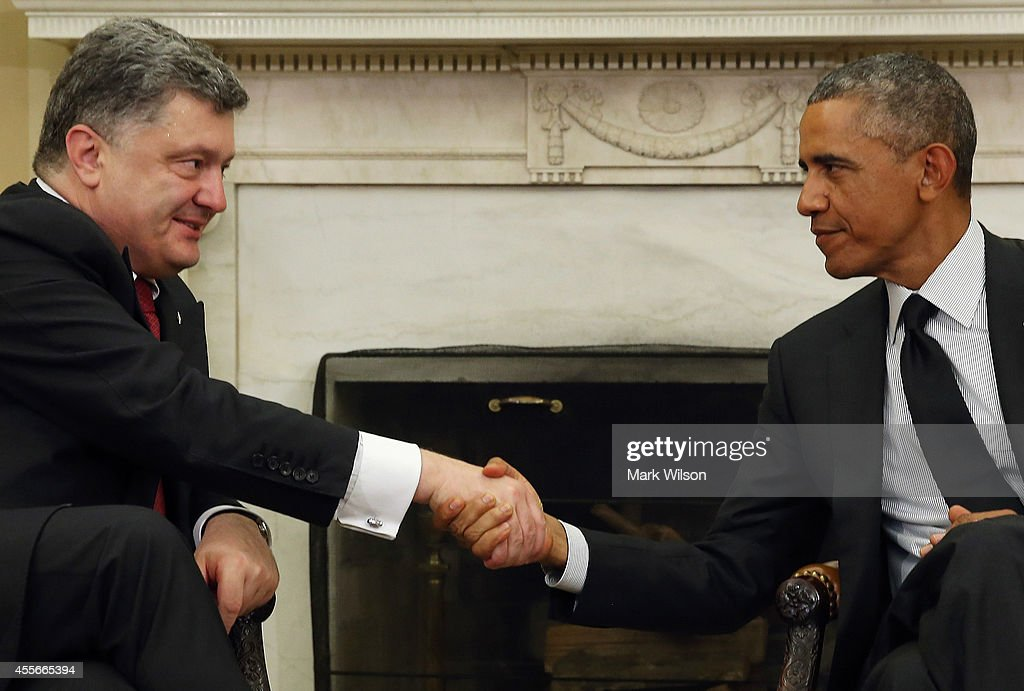 U.S. President <a gi-track='captionPersonalityLinkClicked' href=/galleries/search?phrase=Barack+Obama&family=editorial&specificpeople=203260 ng-click='$event.stopPropagation()'>Barack Obama</a> (R) shakes hands with Ukraine President <a gi-track='captionPersonalityLinkClicked' href=/galleries/search?phrase=Petro+Poroshenko&family=editorial&specificpeople=549382 ng-click='$event.stopPropagation()'>Petro Poroshenko</a> in the Oval Office at the White House, September 18, 2014 in Washington, DC. The two leaders held a bilateral meeting to discuss a strategic aid package for Ukraine for its battle with pro Russian separatists.