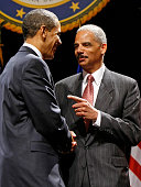 US President Barack Obama shakes hands with US Attorney General Eric Holder during his ceremonial installation at George Washington University March...