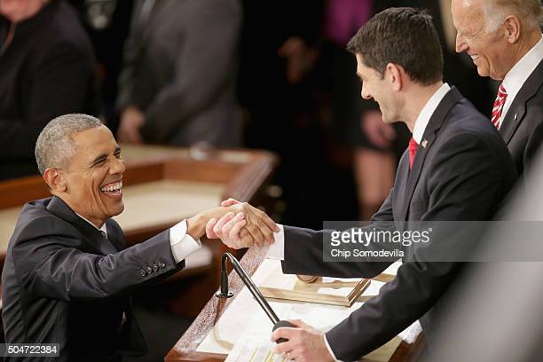 S President Barack Obama shakes hands with US Speaker of the House Rep Paul Ryan as US Vice President Joe Biden looks on before delivering the State...