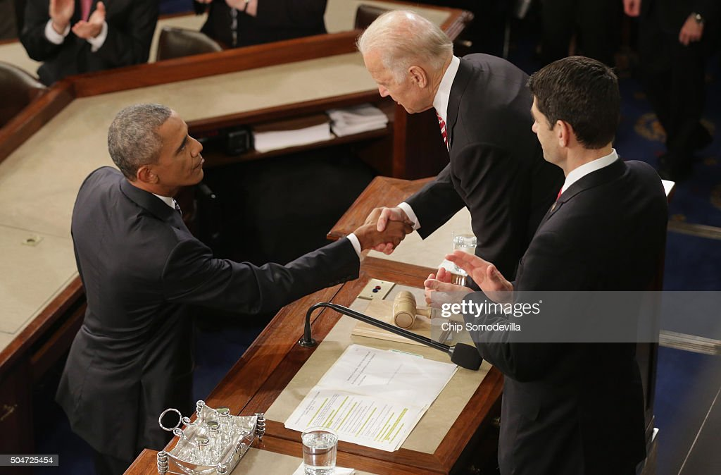 U.S. President Barack Obama (L) shakes hands with U.S. Vice President Joe Biden as U.S. Speaker of the House Rep. Paul Ryan (R) looks on after delivering the State of the Union speech before members of Congress in the House chamber of the U.S. Capitol January 12, 2016 in Washington, DC. In his last State of the Union, President Obama reflected on the past seven years in office and spoke on topics including climate change, gun control, immigration and income inequality. Also pictured are Vice President Joe Biden (L) and U.S. Speaker of the House Rep. Paul Ryan (R-WI).