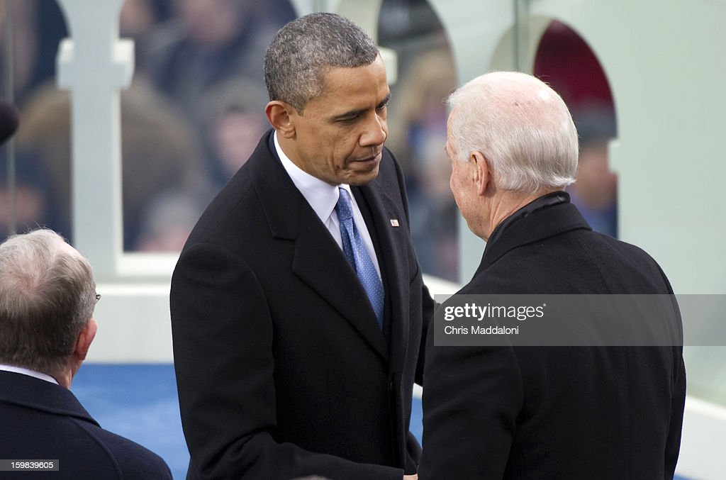 U.S. President Barack Obama shakes hands with Vice President Joe Biden after his speech at the inauguration for Obama's second term of office. More than 600,000 people attended the event.