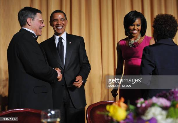 US President Barack Obama shakes hands with White House Correspondents' Association Secretary Peter Maer of CBS News as First Lady Michelle Obama...