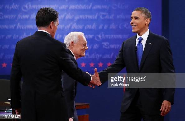 S President Barack Obama shakes hands with with Republican presidential candidate Mitt Romney at the Keith C and Elaine Johnson Wold Performing Arts...