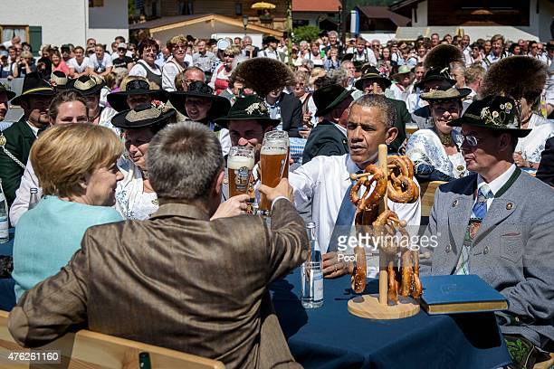 S President Barack Obama shares a Bavarian breakfast with German Chancellor Angela Merkel and her husband Joachim Sauer prior the summit of G7...