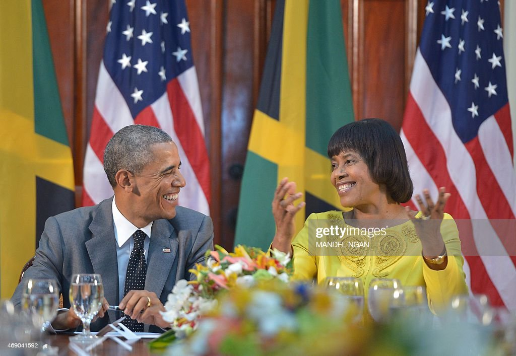 US President <a gi-track='captionPersonalityLinkClicked' href=/galleries/search?phrase=Barack+Obama&family=editorial&specificpeople=203260 ng-click='$event.stopPropagation()'>Barack Obama</a> (L) shares a laugh with Jamaica's Prime Minister <a gi-track='captionPersonalityLinkClicked' href=/galleries/search?phrase=Portia+Simpson+Miller&family=editorial&specificpeople=4183773 ng-click='$event.stopPropagation()'>Portia Simpson Miller</a> during a meeting at Jamaica House on April 9, 2015 in Kingston.