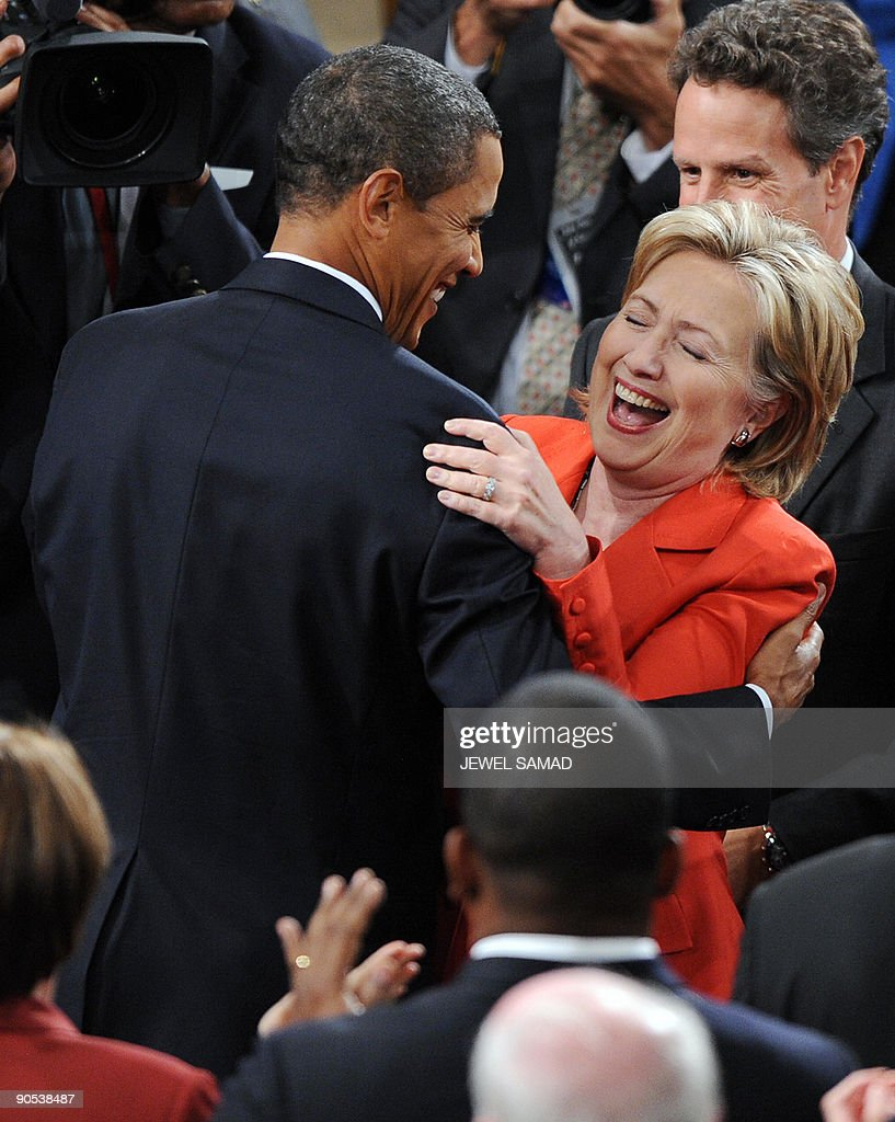 US President Barack Obama shares a laugh with Secretary of State Hillary Clinton as he arrives to address a joint session of Congress on his embattled healthcare reform plan at the US Capitol in Washington, DC, on September 9, 2009. Obama, whose approval ratings have taken a hit, hopes to regain control of healthcare reform, one of his top legislative priorities. AFP PHOTO/Jewel SAMAD