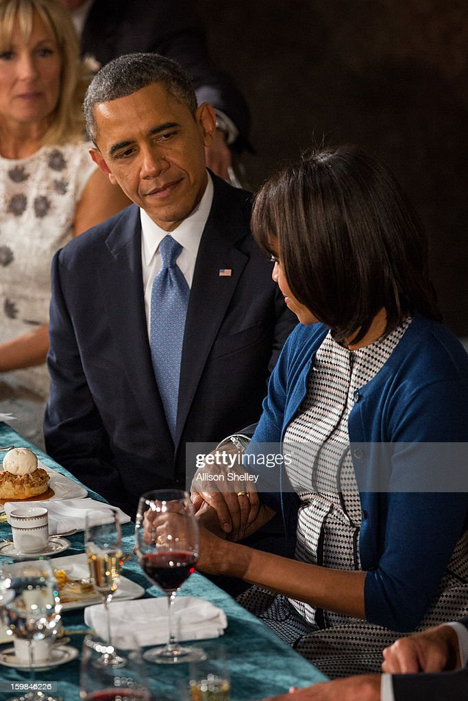 U.S. President <a gi-track='captionPersonalityLinkClicked' href=/galleries/search?phrase=Barack+Obama&family=editorial&specificpeople=203260 ng-click='$event.stopPropagation()'>Barack Obama</a> shares a moment with first lady <a gi-track='captionPersonalityLinkClicked' href=/galleries/search?phrase=Michelle+Obama&family=editorial&specificpeople=2528864 ng-click='$event.stopPropagation()'>Michelle Obama</a> at the Inaugural Luncheon in Statuary Hall on inauguration day at the U.S. Capitol building January 21, 2013 in Washington D.C. President Obama was ceremonially sworn in for his second term today.