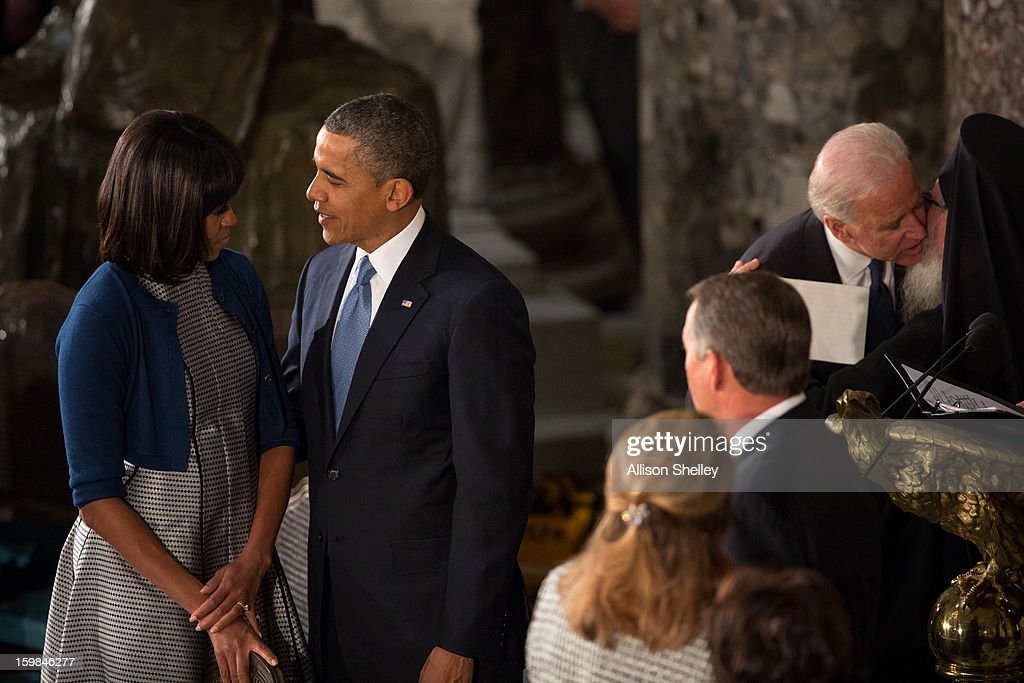 U.S. President Barack Obama shares a moment with first lady Michelle Obama at the Inaugural Luncheon in Statuary Hall on inauguration day at the U.S. Capitol building January 21, 2013 in Washington D.C. President Obama was ceremonially sworn in for his second term today.