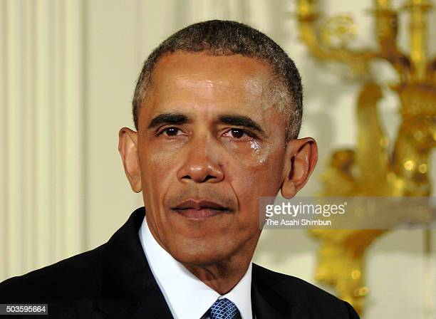 US President Barack Obama sheds tears as talks about the victims of the 2012 Sandy Hook Elementary School shooting and about his efforts to increase...