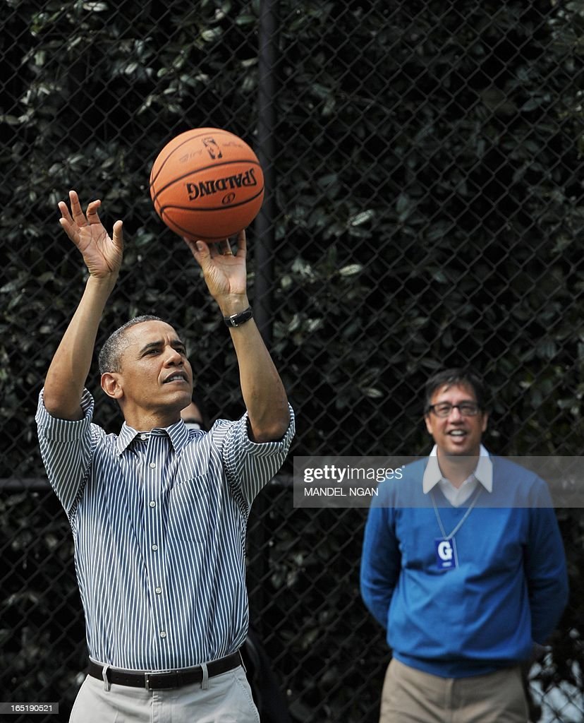 US President Barack Obama shoots a basket as his friend Mike Ramos (R) watches as Obama plays basketball with children during the annual Easter Egg Roll on April 1, 2013 on the South Lawn of the White House in Washington, DC. AFP PHOTO/Mandel NGAN