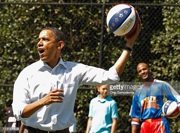 US President Barack Obama shoots a basketball while participating in a 'Let's Move' clinic with members of the NBA WNBA and the Harlem Globetrotters...