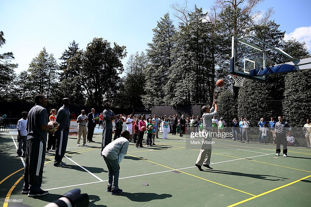 U.S. President <a gi-track='captionPersonalityLinkClicked' href=/galleries/search?phrase=Barack+Obama&family=editorial&specificpeople=203260 ng-click='$event.stopPropagation()'>Barack Obama</a> shoots the ball while playing basketball with children during the annual Easter Egg Roll on the White House tennis court April 1, 2013 in Washington, DC. Thousands of people are expected to attend the 134-year-old tradition of rolling colored eggs down the White House lawn that was started by President Rutherford B. Hayes in 1878.