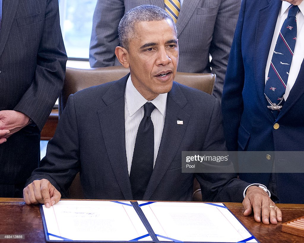 president barack obama signs hr 1209 in the oval office at the white house on may barak obama oval office golds